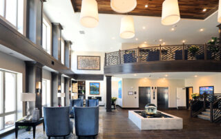 Assisted living senior community common area lobby with chairs and balcony stylish design interior in golden valley mn
