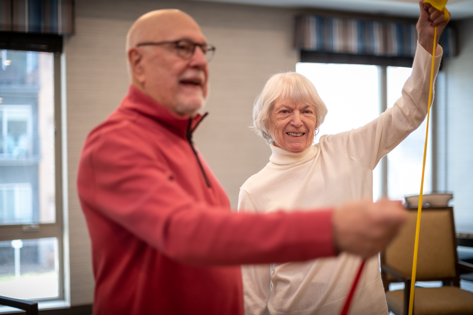 man and woman senior living community facility assisted living exercise activities