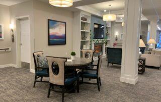 Senior living community assisted living common space recreation room entertainment modern design apartment