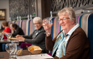 Woman wine tasting restaurant senior living community activities events assisted living golden valley mn