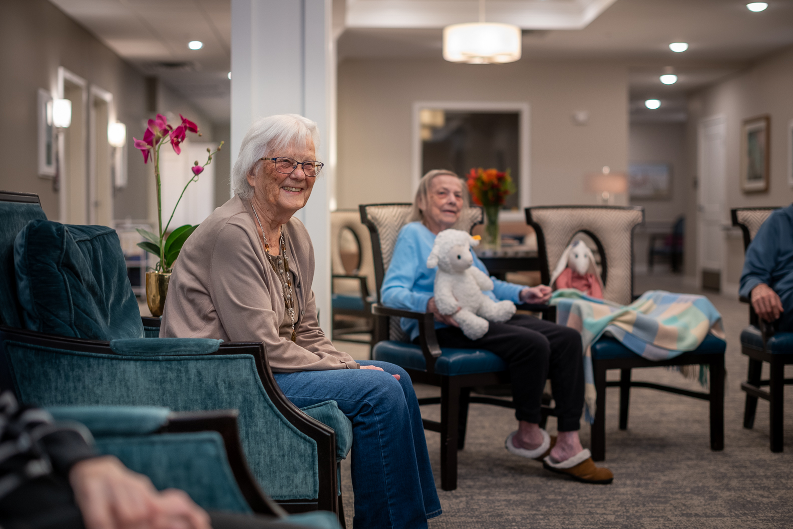 two women smiling stuffed animals common room senior living assisted living facility apartments memory care patients golden valley minnesota