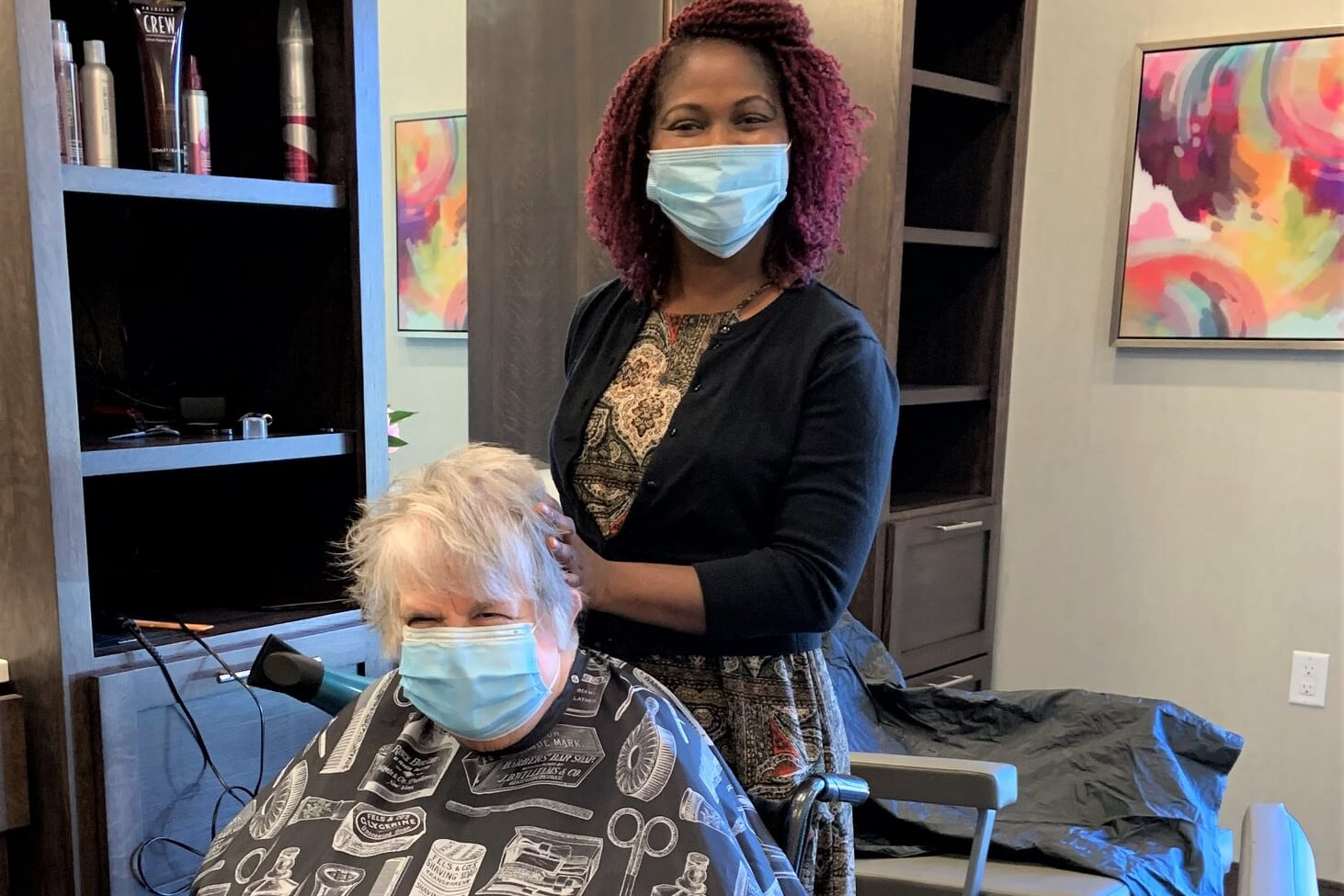 hair stylist doing woman's hair in salon beauty salon treatment senior living community amenities golden valley mn