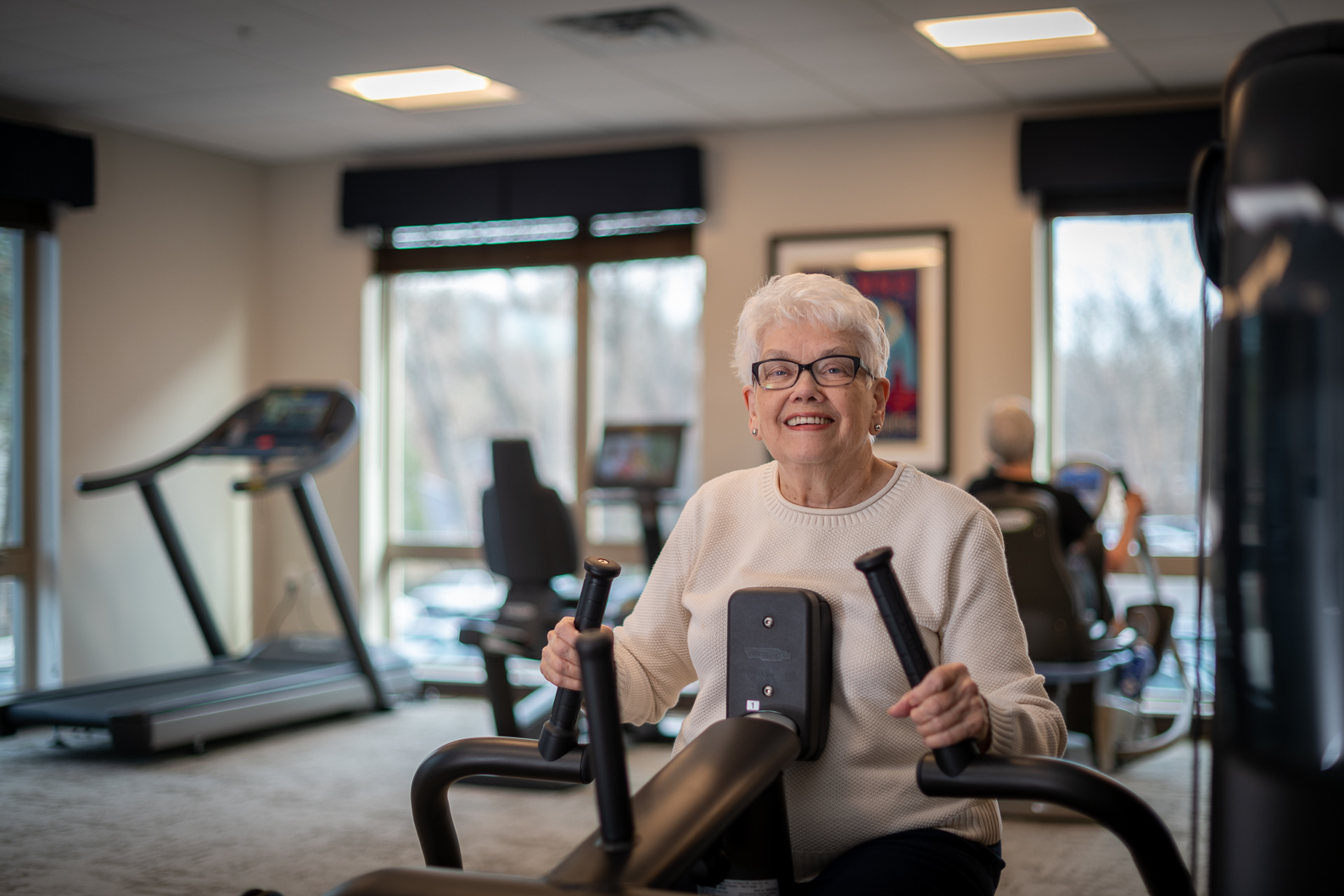 Senior living apartments resident exercise gym room activity community golden valley mn